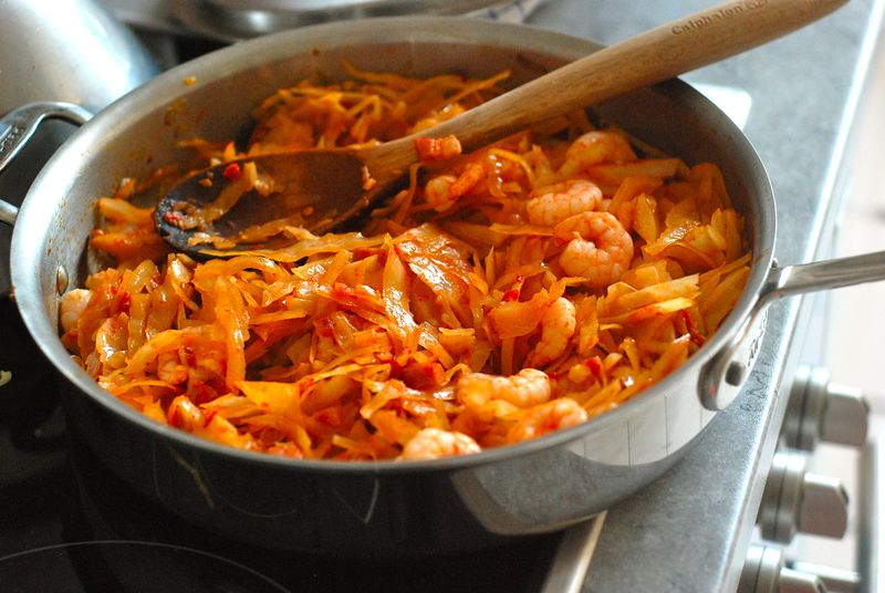 Spicy sautéed cabbage with shrimp, bacon and tomatoes